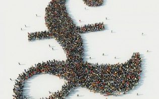 Aerial view of crowd of people arranged in British pound symbol
