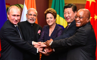 Russia President Vladimir Putin, India Prime Minister Narendra Modi, Brazil President Dilmar Rouseff, Chinese President Xi Jinping and President Jacob Zuma take a BRICS leader's family photo at the G20 Leaders' Summit in Brisbane, Australia. Credit@GovernmentZAG20SumitDoC