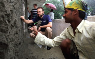 Mr Ben Reese, AusAID representative learns first-hand the processes of reconstructing a school building in an effort to make it more earthquake proof. Jana Bikash Secondary School, Matatirtha, AusAID Kathmandu, Nepal. Photo by Jim Holmes for AusAID. Credit@Department of Foreign Affairs.