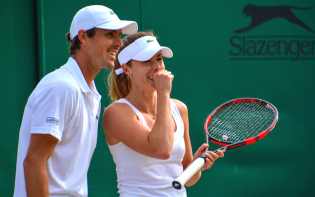 Edouard Roger Vasselin and Alize Cornet during a mixed doubles match.Credit@Carine06viaflickr.com